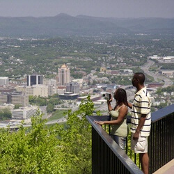 couple looking over patio over downtown roanoke