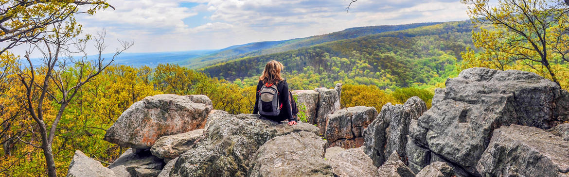 woman sitting on blue ridge mountain near hotel roanoke