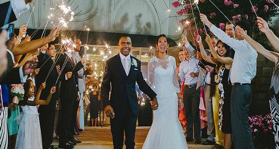 newly weds walking under sparklers