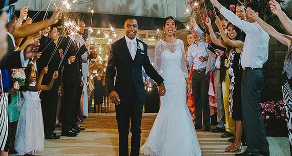 newlyweds exiting under sparklers