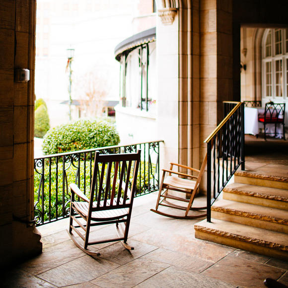 two rocking chairs on an outdoor patio